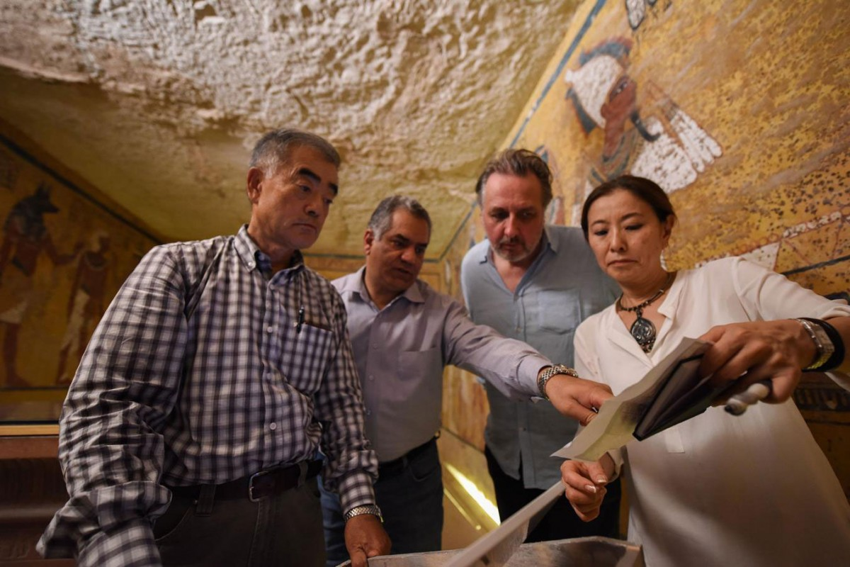 Egyptian and Japanese experts in Tutankhamun's tomb.