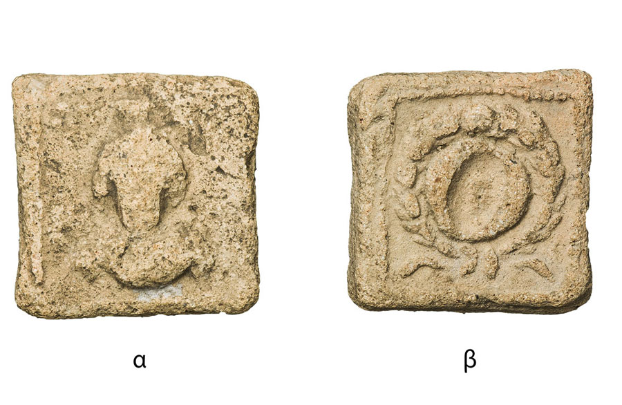 Fig. 2. Square shaped token. 16x16 mm. Side a: Bust of a deity flanked by stars. Side b: A wreath. (Numismatic Museum 229/2005).Epigraphic and Numismatic Museum, Athens. ©The copyright belongs to the Ministry of Culture and Sports.