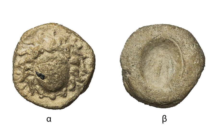 Fig. 6. Circular token. 16mm. Side a: Head of Medusa facing the front. Side b: Impression of an oval stamp with image of the goddess Fortune/Tyche(Τύχη)(?) on the left. (Numismatic Museum 264/2005). Epigraphic and Numismatic Museum, Athens. ©The copyright belongs to the Ministry of Culture and Sports