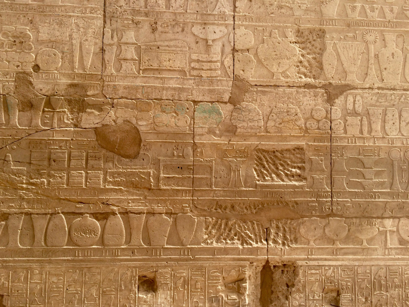 Detail of a relief from Karnak, Luxor, Egypt. Glass ingots (partly coloured blue in the center of the photo) are seen among other tributes donated to the temple by Thutmosis III after his Syrian war campaign. Photo: Jeanette Varberg, Moesgaard Museum.
