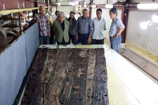 Once they have removed all timber from the pit and restored it the team hope to reconstruct the boat and display it next to its sister. Photo Credit: Al Ahram.