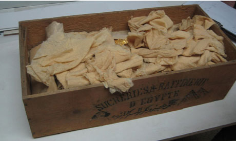 The box with the golden chips was found in a storage room at the Egyptian Museum. Photo Credit: Ahram Online.