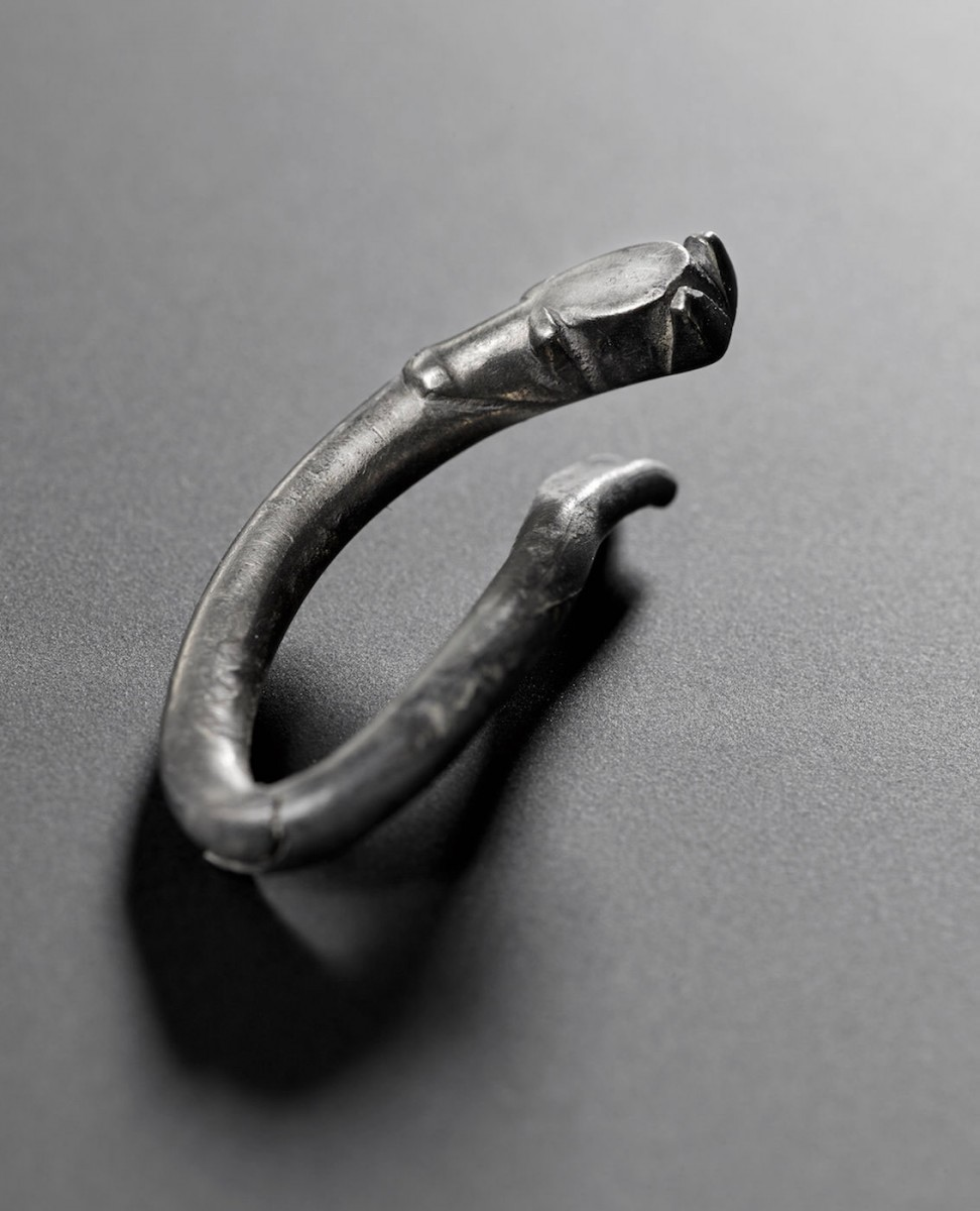 A small, animal-like brooch fashioned out of silver. Photo Credit: Live Science.