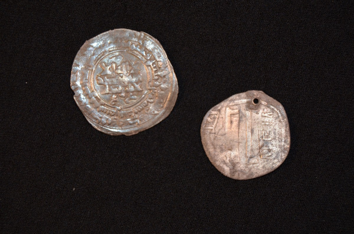 Two silver coins were also discovered on site. It is likely that they came from as far away as Afghanistan. Photo Credit: Museum Silkeborg/Science Nordic.