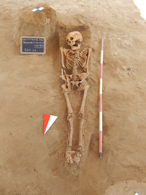 A skeleton found in a tomb at Casal Bernocchi. Photo Credit: Il Messaggero.