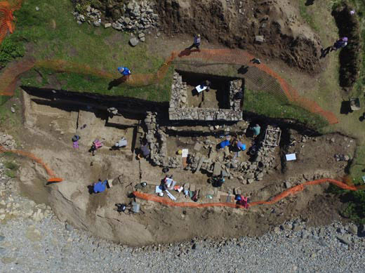 The medieval chapel and the underlying rectilinear enclosure. Scale: the square on the right enclosure wall is a 1m planning grid. Photo Credit: Stephen Rees/DEFUD Archaeological Trust.