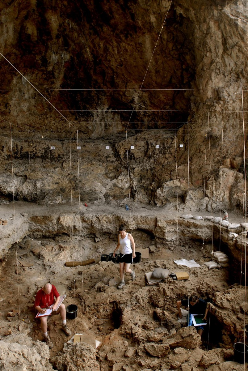 Hebrew University archaeologists uncover 12,000 year old grave inside a cave in northern Israel. Credit: Naftali Hilger.