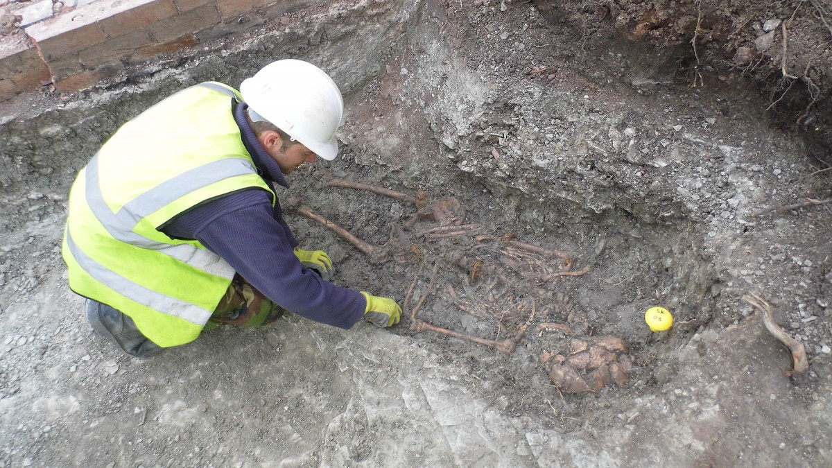 Fig. 1. An archaeologist excavates one of the skeletons in the Roman cemetery at Western Road.