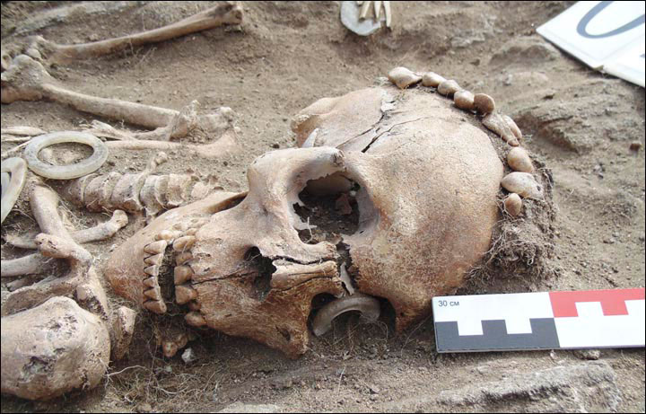 The man's skeleton had a ring made of rare white jade over one eye socket. Photo Credit: Dmitry Kichigin/The Siberian Times.