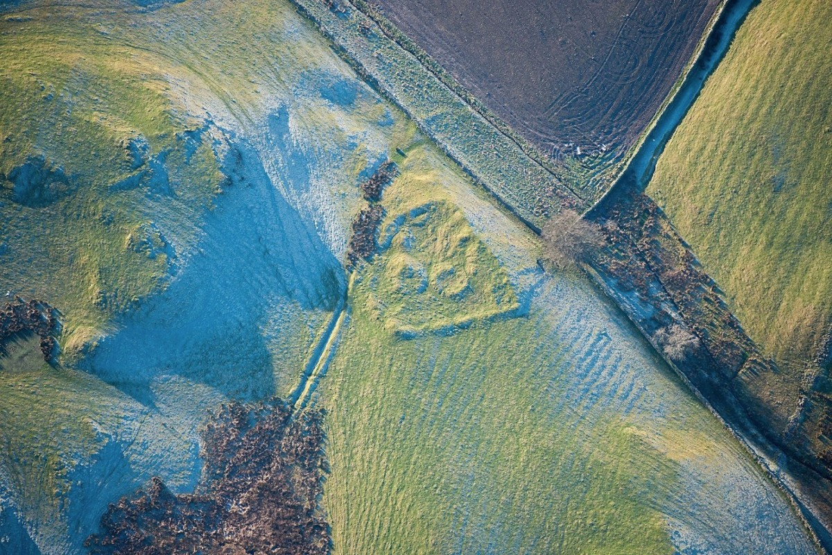 The low winter sunlight in this aerial photograph reveals subtle details of this late Iron Age or Roman settlement.