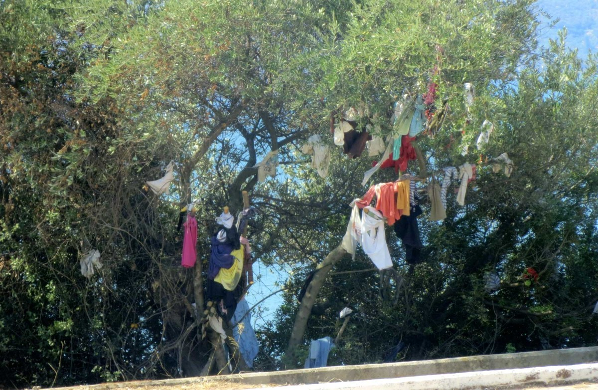 People often hang clothes, handkerchiefs or threads as votive offerings from branches of trees that are close to some church.