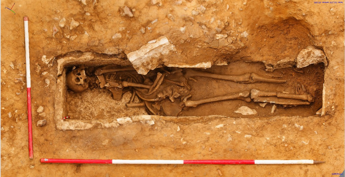 The man's feet were folded underneath his legs on account of the sarcophagus being too short for the body.