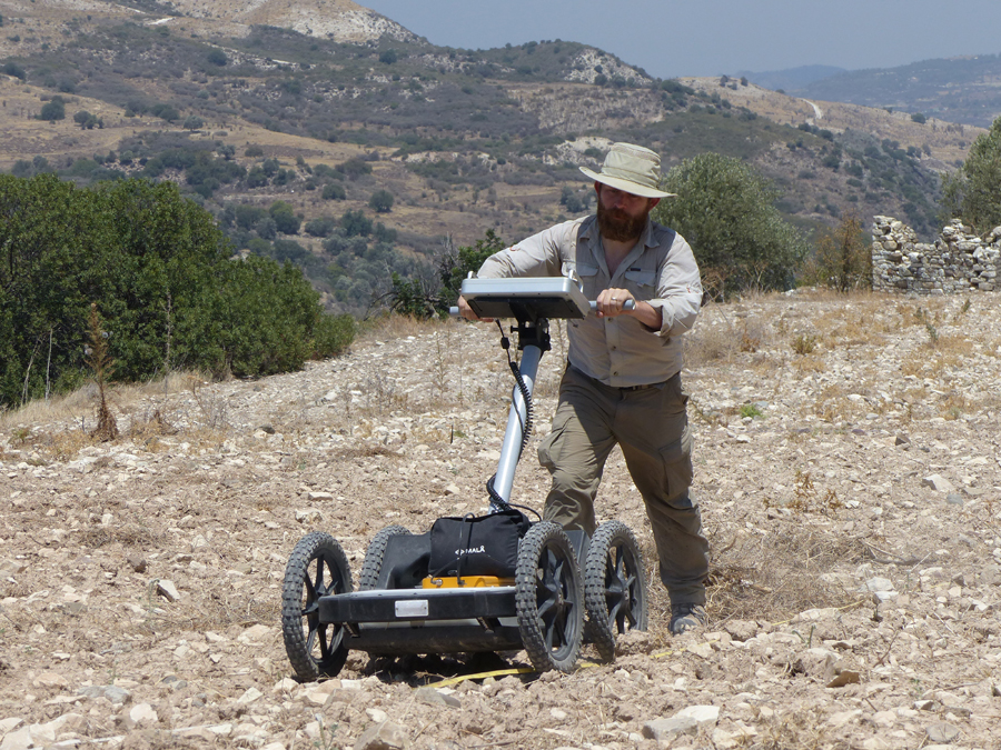 Fig. 2 Dr. Tate Paulette from Brown University using the GPR equipment provided by the Cyprus Institute (photo courtesy of Alison McCaig).