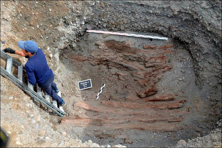 The two skeletons were found in the riverside tomb with fur remnants and other items nearby. Photo Credit: Nikita Konstantinov/The Siberian Times.