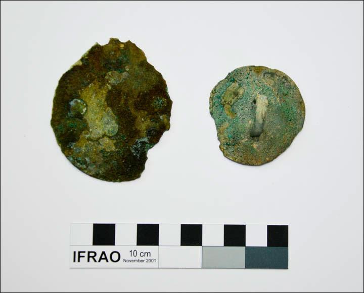 Bronze mirrors and a ceramic vessel were found in the grave. Photo Credit: Nikita Konstantinov/The Siberian Times.