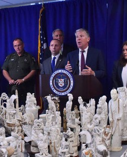 Cyrus R. Vance Jr., the Manhattan district attorney, with ivory items seized from a store accused Thursday of selling them illegally. Photo Credit: Louis Lanzano/The New York Times.