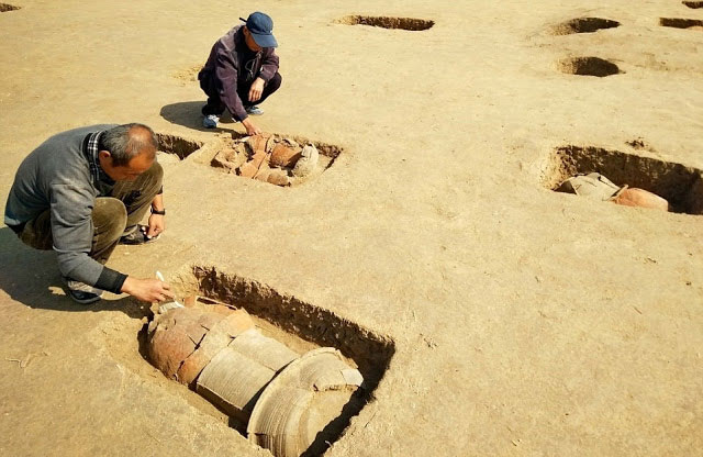 Archaeologists work at the ancient tomb site in Huanghua City, north China's Hebei Province.  Photo Credit: Xinhua/Yang Shiyao/TANN.