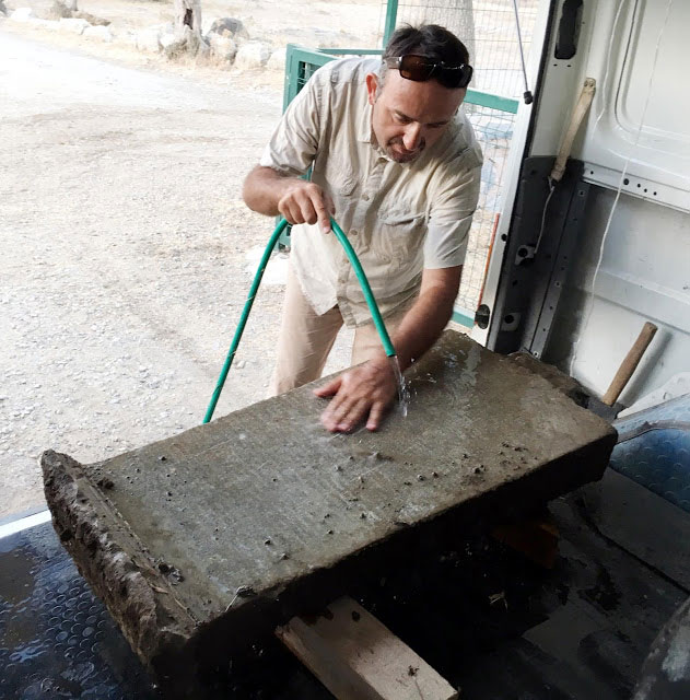 The inscribed stele is cleaned after excavation. Photo Credit: DHA/Archaeology News Network.