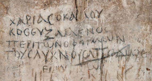Some of the graffiti found on the walls of the basilica in the Agora of Smyrna. Photo Credit: AA/The Archaeology News Network.