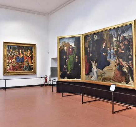 The Portinari Tryptich, right, by the Flemish artist Hugo van der Goes, in one of the reopened halls. Credit Maurizio Degl Innocenti/European Pressphoto Agency/The New York Times.