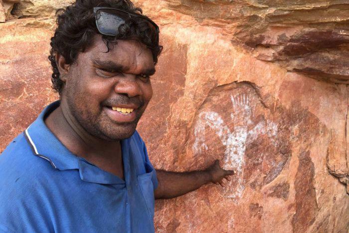 Balanggarra ranger Wesley Alberts says the rock art brings back many memories. Photo Credit: Erin Parke/ABC News.