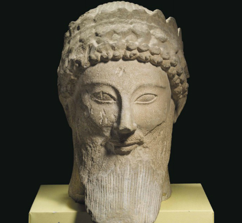 Cypriot limestone head of a male votary. 500-450 BC.