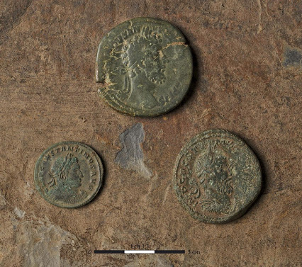 Two sesterces struck in Rome 2nd cent. and Trier 3rd cent. and a nummus struck in Trier 4th cent. Credit: © Emmanuelle Collado, Inrap