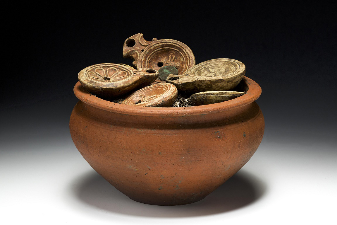 Cooking pot filled with oil lamps and coins. Credit: Aargau Canton Archaeology Department, Bela Polyvas.