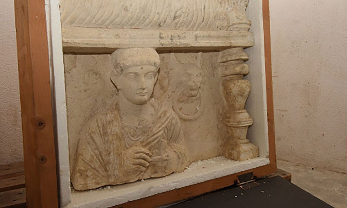A funeral bas-relief from Palmyra in Syria discovered during a custom control on April 2013 in the free ports of Geneva. Photo Credit: TANN/AFP/Getty Images.