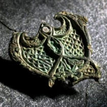 How did a fitting from an Irish horse's harness end up as a brooch for a Norwegian Viking woman?