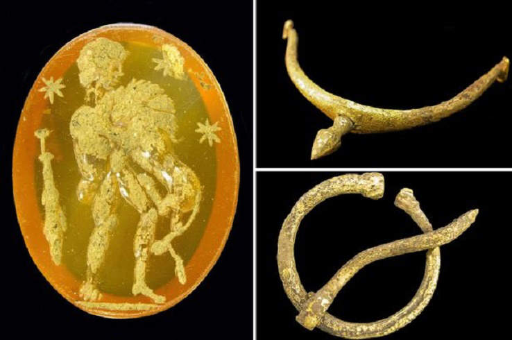 A carnelian intaglio of Hercules and the Lion, a brass plated boot spur and a  bronze plated penannular brooch. Credit: The Bowes Museum