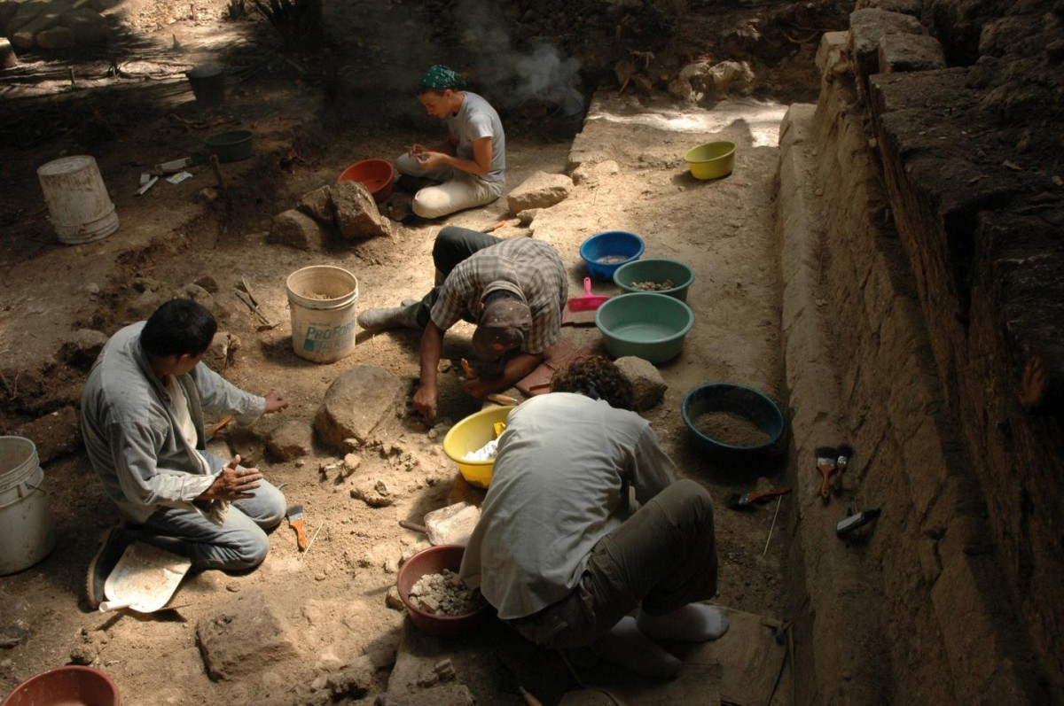 Archaeologists excavate the Royal Palace of Ceibal, which was burned during the classic Maya collapse in the 9th century. Credit: Takeshi Inomata/University of Arizona.