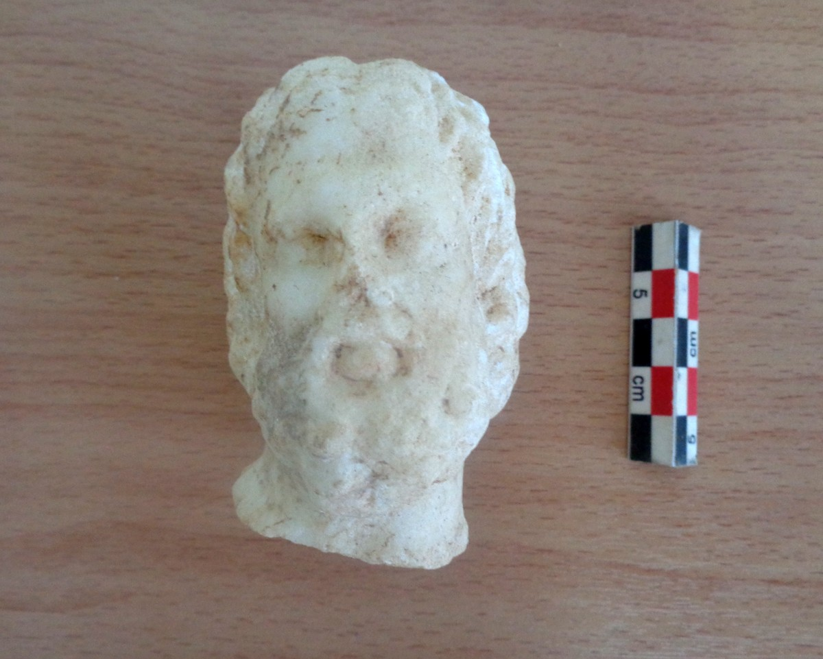 Building 1. Small marble head of a bearded man (Asklepios).