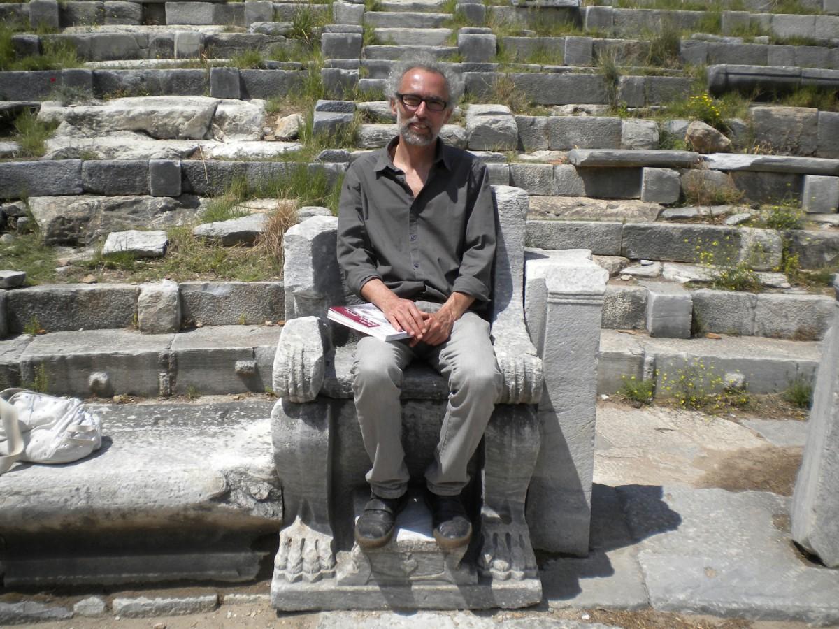 Alexandros Mazarakis Ainian in the theatre of ancient Priene, 2011 (photo: Alexandra Alexandridou).
