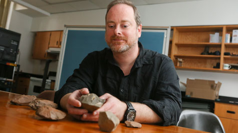 William & Mary archaeologist Neil Norman discusses a set of almost unbelievably ancient stone tools that  he brought back from a site on the horn of Africa [Credit: Stephen Salpukas]