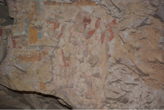 On the northern part of the eastern wall, there is a wall painting depicting the tomb owner followed by other human figures.