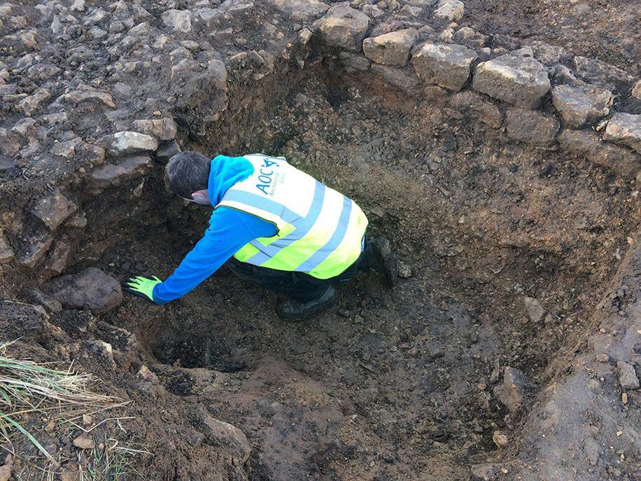 Archeologists have found lots of linear ditches, quarry pits, kilns, coins and a cemetery, as well as unexpected remains like a stone wall near to a metalled/roughly paved surface with an earlier ditch underneath. Photo credit: Lincolnshire County Council.