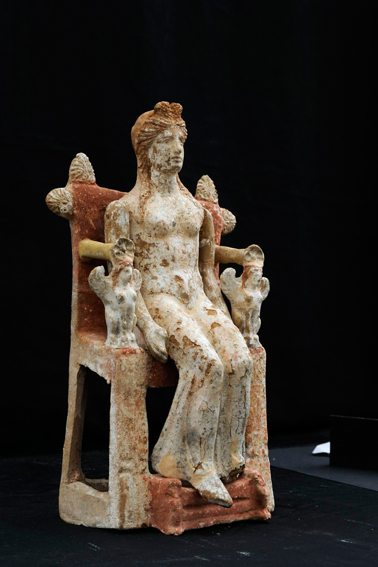 Fig. 9. Figurine of enthroned woman. Her upper limbs are articulated and her throne richly decorated. 4th c. BC. Thebes. Thebes Archaeological Museum.