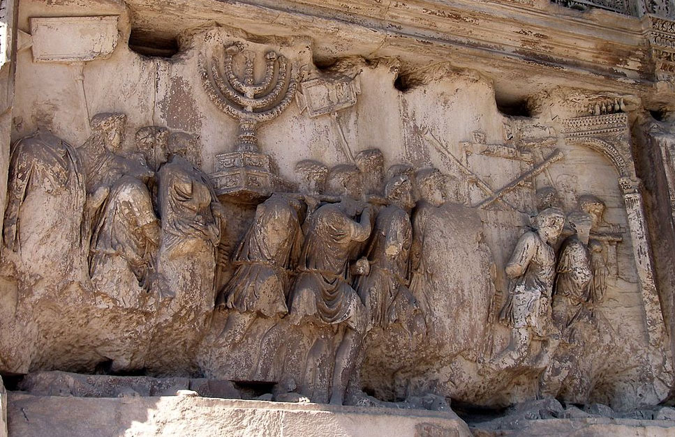 In this part of Titus' triumphal procession (from the Arch of Titus in Rome), the treasures of the Jewish Temple in Jerusalem are being displayed to the Roman people. Hence the Menorah. Source: Wikimedia Commons
