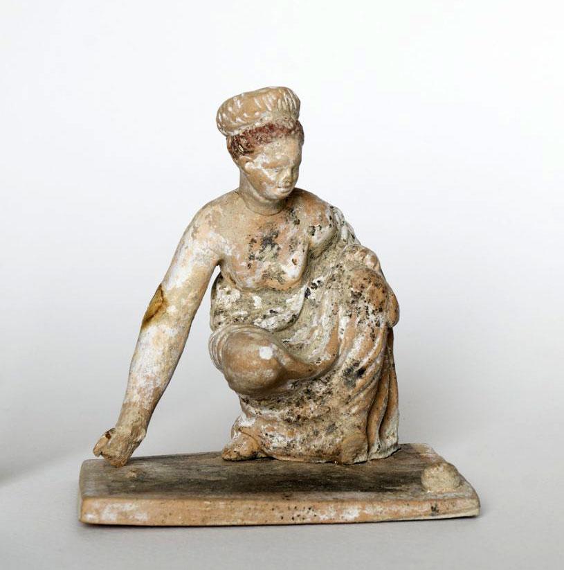 Femal figure playing astragali (knucklebones). End of 4th c. BC. Amphipoli.