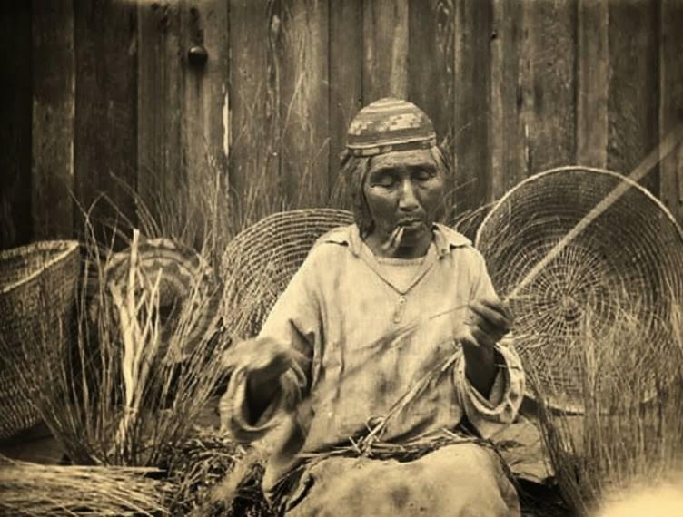 Karuk Indian woman making baskets.