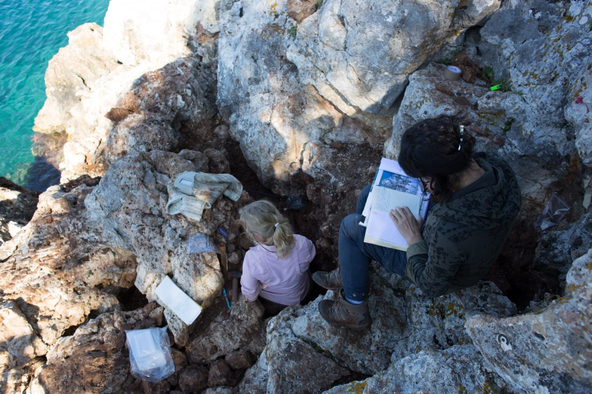 Fig. 14. Excavating the coastal cave on Kythros and conducting geoarchaeological sampling.