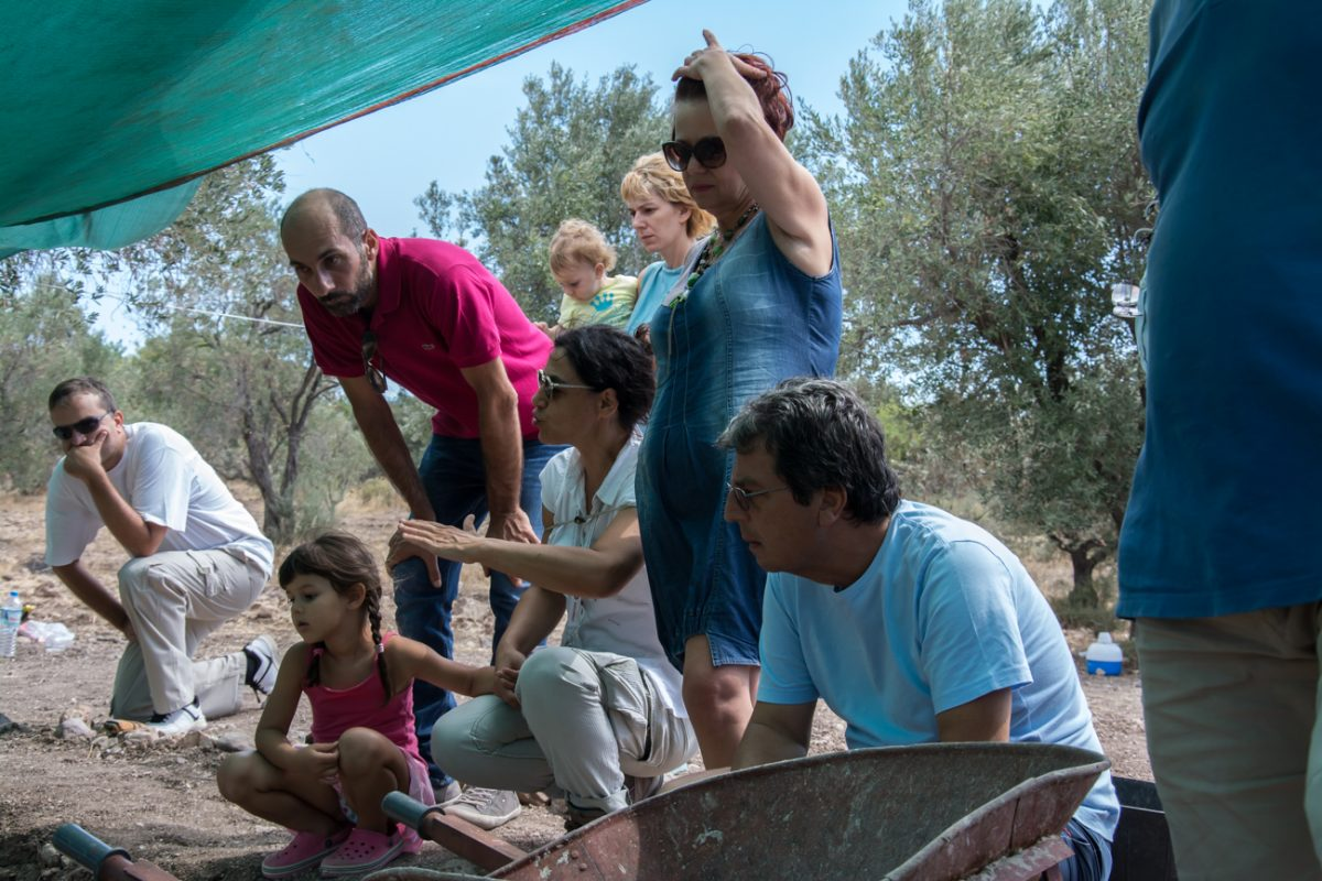 Fig. 16. Talking to visitors at the excavation of Rodafnidia about the Palaeolithic heritage of Lesbos and its contribution to the narrative of Europe's early history.