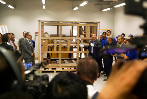 Tarek Tawfik, director of the Grand Egyptian Museum, speaks to reporters in front of king Tutankhamun's funerary bed upon its arrival at the Grand Egyptian Museum in Cairo, Egypt, Tuesday, May 23, 2017. (AP Photo/Amr Nabil)