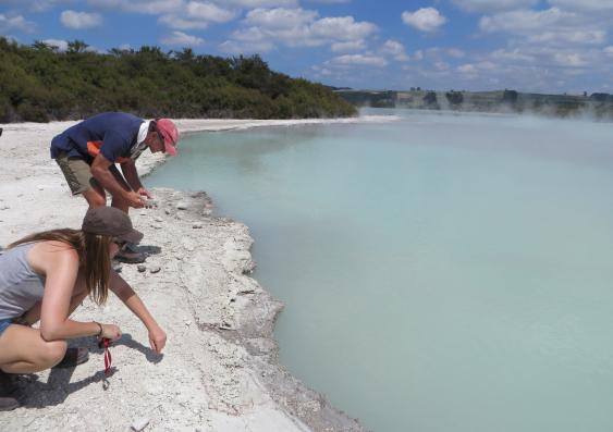 Professor Martin Van Kranendonk and Tara Djokic at Lake Rotokawa in New Zealand studying modern hot springs. Photo: Kathleen Campbell