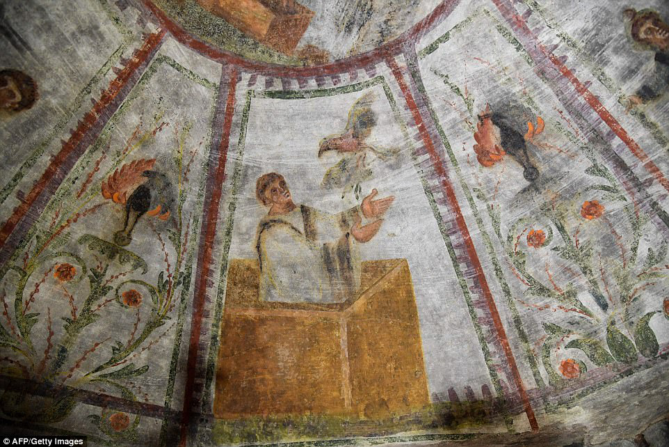 A detail of the restored fresco of 'dei Fornai' (bakers) cubicle, is pictured. Small peacock images can be seen either side of the man - a pagan sign of the afterlife. The Domitilla catacombs, named after a member of the Roman family that commissioned the burial grounds, are the largest in Rome. © AFP/Getty Images