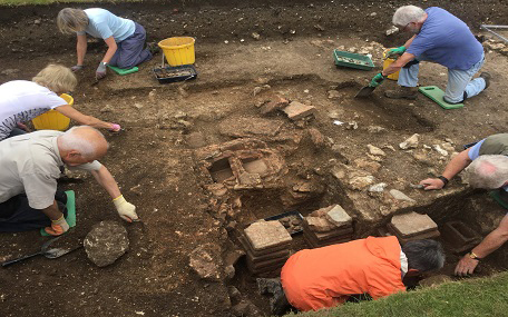 A team of archaeologists and volunteers  uncovering the remains of a private Roman bathhouse in Chichester's Priory Park.
