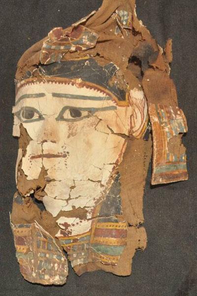 A painted mummy mask.