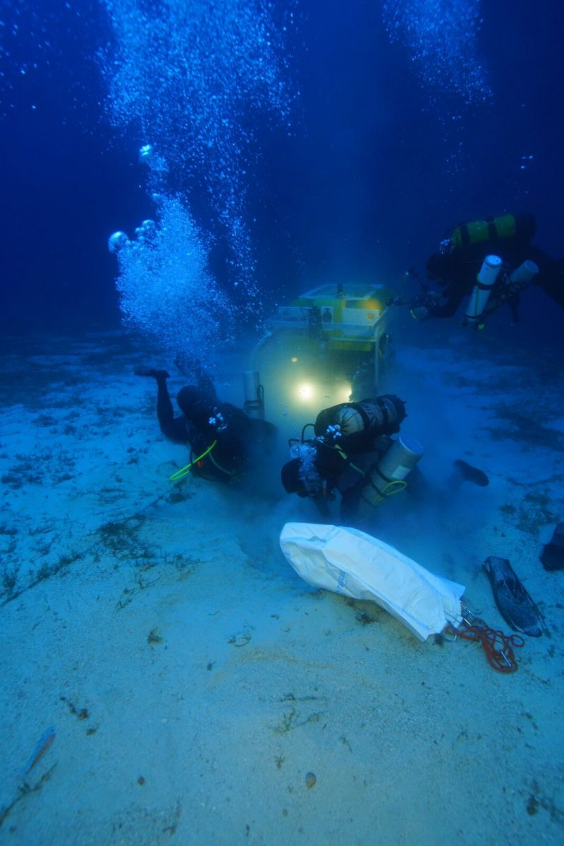 Archaeologists and the ROV robot work to recover an ancient North African amphora. Photo by Vasilis Mentogianis. Credit: Ephorate of Underwater Antiquities-Hellenic Ministry of Culture and Sports / RPM Nautical Foundation