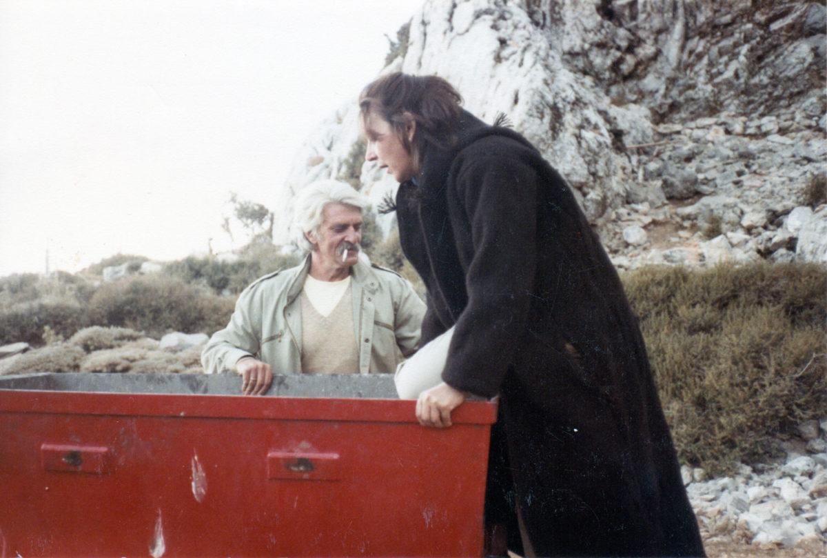 "Fig. 18. Efi Sapouna-Sakellarakis wearing a shepherd's cape («γαμπάς») and Yannis Sakellarakis on the ""railroad"" at Ideon Andron, August 1985."